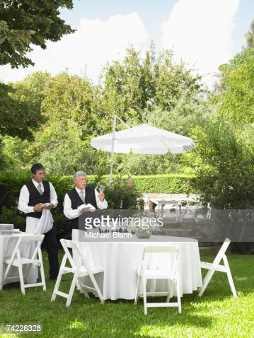 Two men preparing garden party stock photo getty images for Pandy s garden center