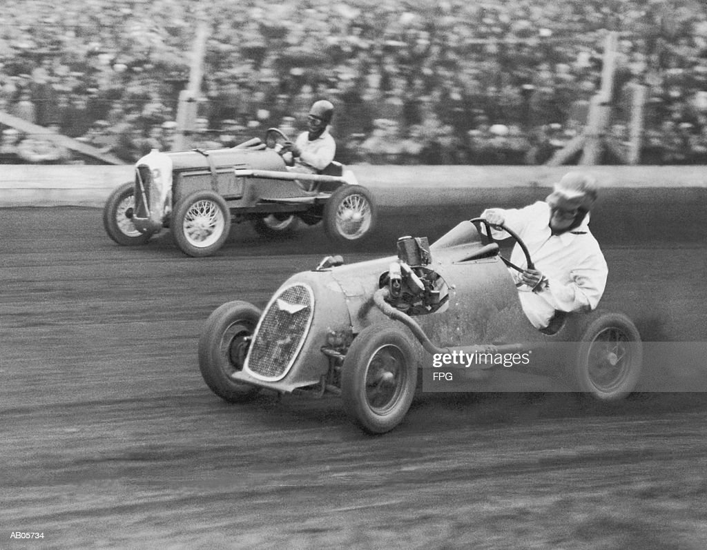 Two men racing midget cars (B&W) : Stock Photo