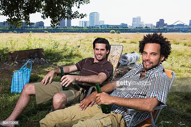 Two men relaxing in the sun