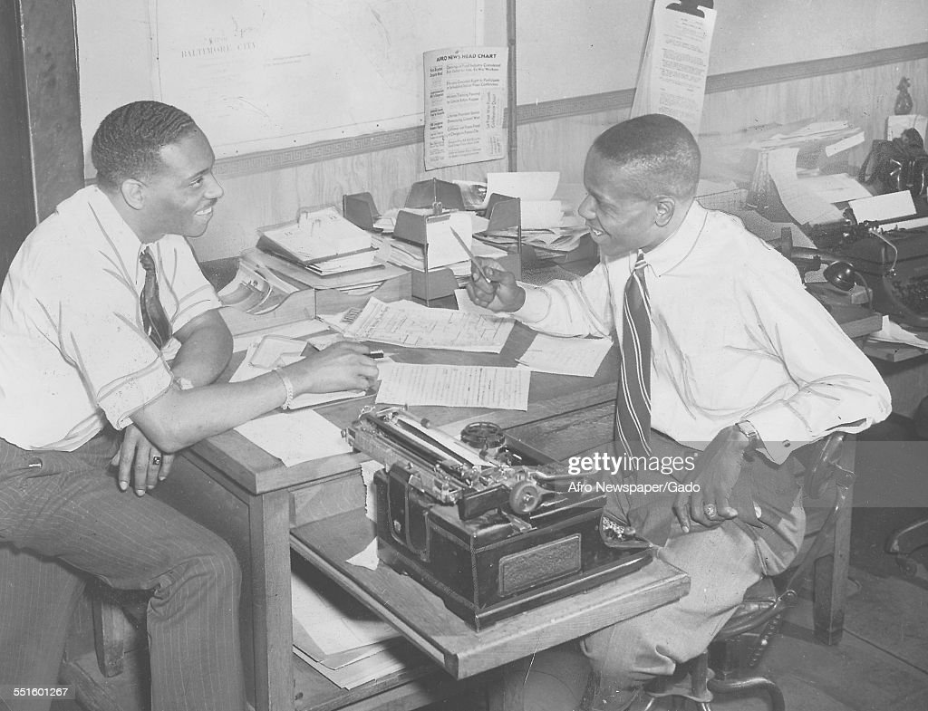 Two men, reporters at desks at the Afro American newspaper offices in Baltimore, Baltimore, Maryland, 1945.
