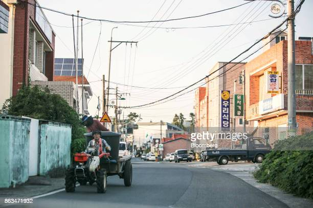 Two men ride in a tractor along a road in Ulju Ulsan province South Korea on Thursday Aug 31 2017 South Korea has the worlds sixthlargest nuclear...