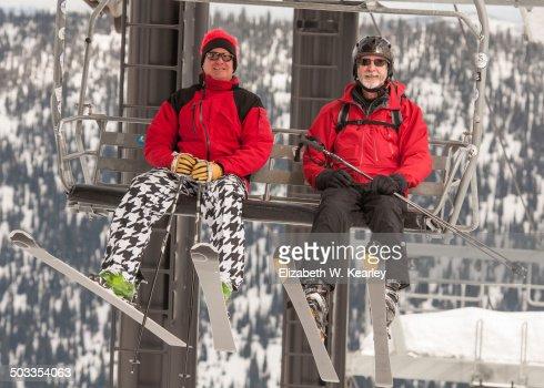 Two men riding ski lift