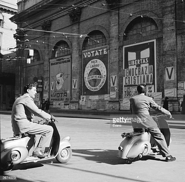 Two men riding Vespa scooters in Italy