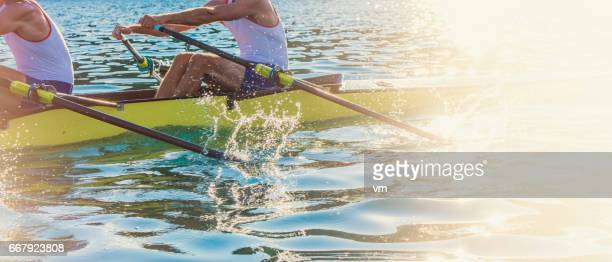Two men rowing in the rowboat