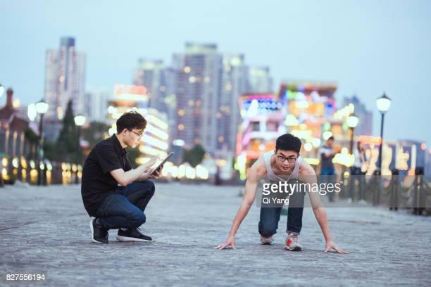 Two men run in the urban park,Shanghai,China