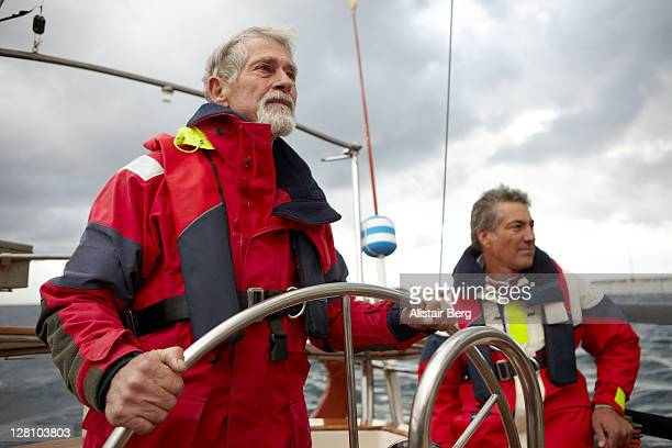 Two men sailing a yacht