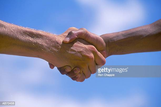Two men shaking hands, close-up