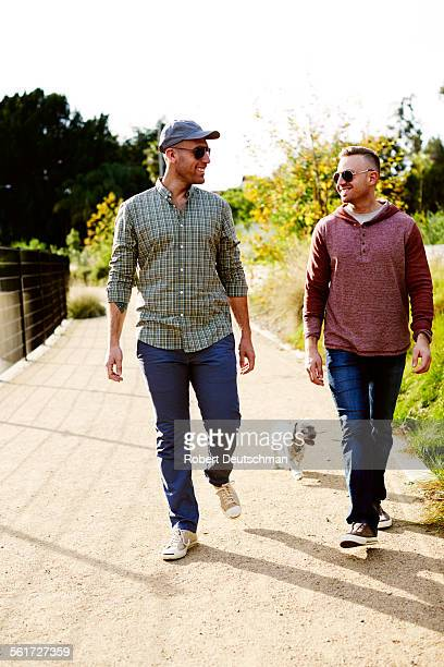 Two men sharing a laugh during a walk.