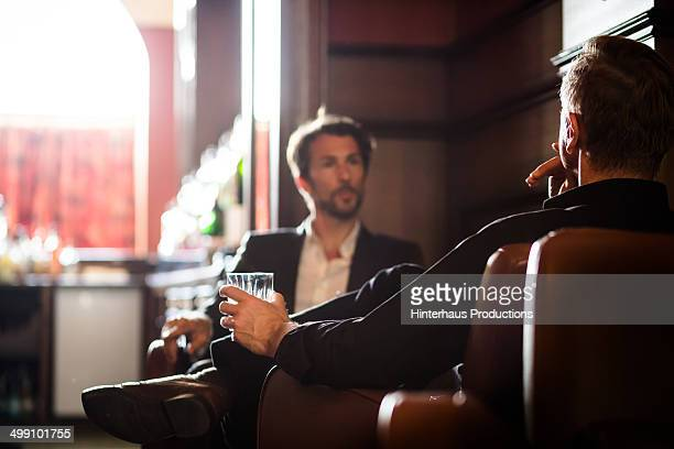 Two men sitting in a bar