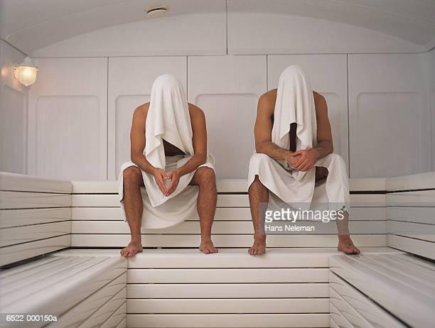 Two Men Sitting in Sauna