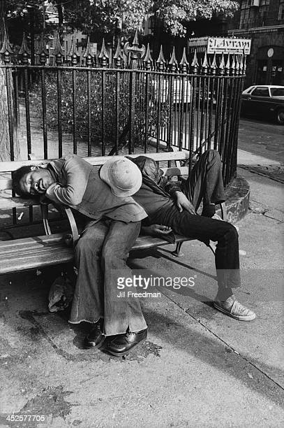 Two men sleep on a park bench in Abingdon Square Park Greenwich Village New York City 1977