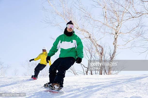 Two men snowboarding