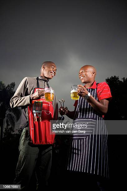 Two men socializing with beer in their hands, KwaZulu-Natal, South Africa