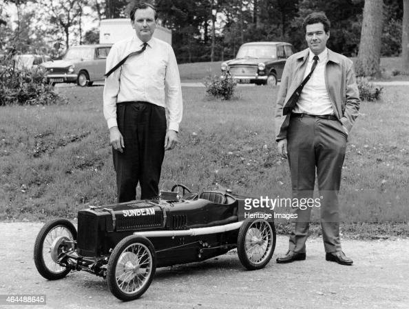 Two men standing by a miniature Sunbeam pedal car 1960s