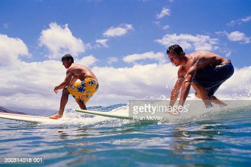 Two men surfing in sea : Stock Photo
