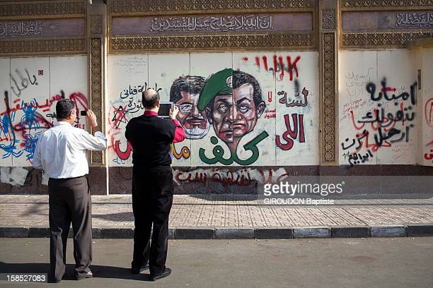 Two men take pictures of Graffiti on December 8,2012 in Cairo,Eqypt.