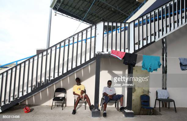 Two men take shelter from the sun at a shelter in the Sir Vivian Richards Cricket Stadium on September 20 2017 in North Sound Antigua and Barbuda...