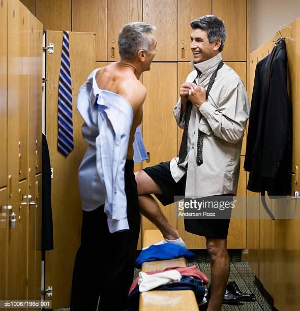 Two men talking in locker room