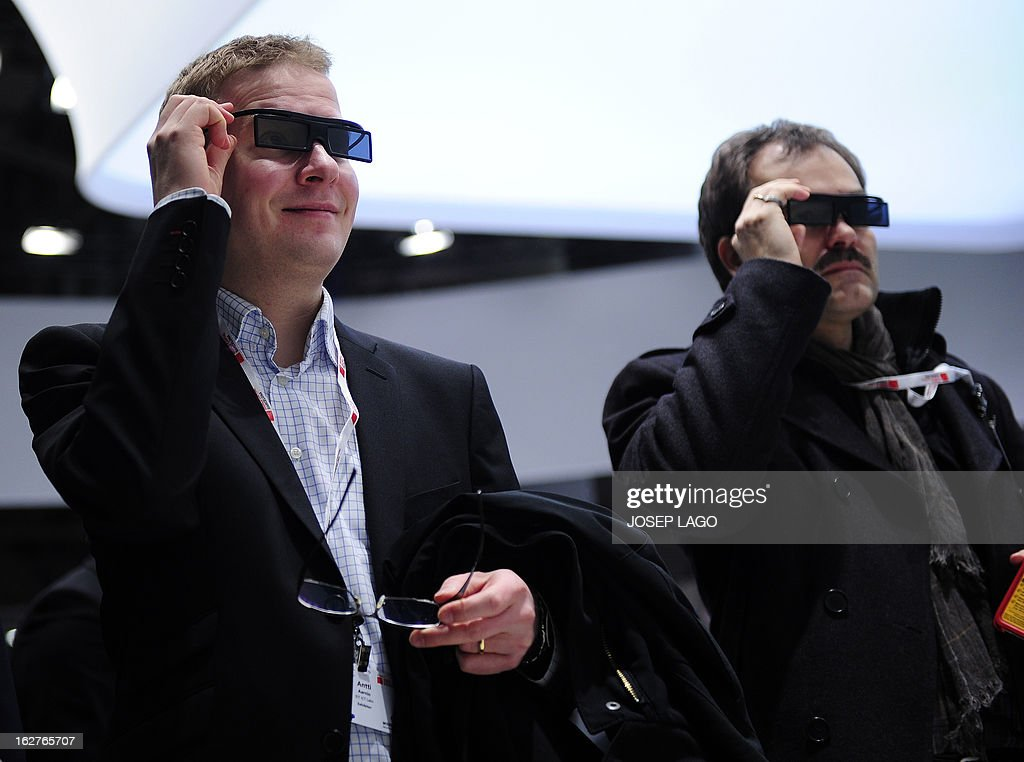 Two men test a new Samsung 3D device in Barcelona on February 26, 2013, on the second day of the 2013 Mobile World Congress. The 2013 Mobile World Congress, the world's biggest mobile fair, is held from February 25 to 28 in Barcelona.