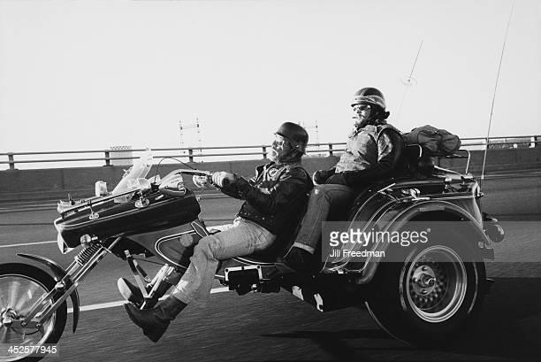 Two men travel on a three wheeled motorcycle USA circa 1980