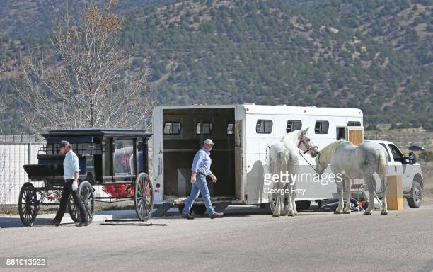 Two men unload horses and a carriage that will be used for the funeral of Heather Lorraine Alvarado on October 13 2017 in Enoch Utah Alvarado was a...