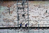 Two men walk at the explosion site of the water park in Pali district in New Taipei City on June 28 2015 More than 500 people were injured almost 200...