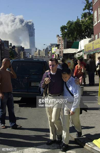 Two men walk away from the terrorist attack on the World Trade Center on Sept 11 2001
