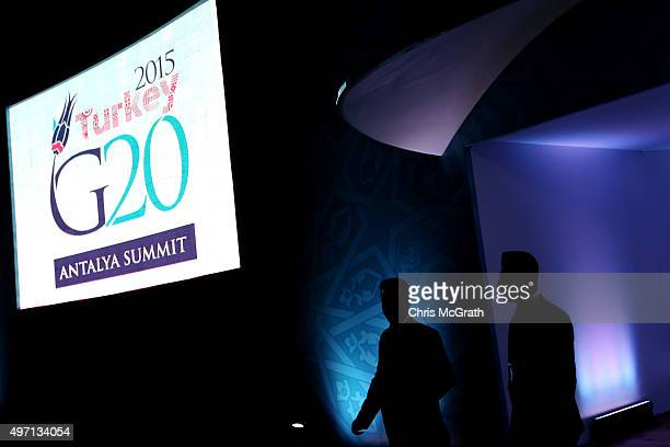 Two men walk out of a G20 venue ahead of the start of the G20 Turkey Leaders Summit on November 14 2015 in Antalya Turkey World leaders delegates and...