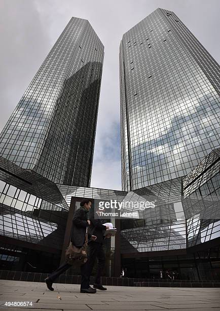 Two men walk past the headquarters of German bank Deutsche Bank on October 29 2015 in Frankfurt Germany Deutsche Bank announced at a press conference...