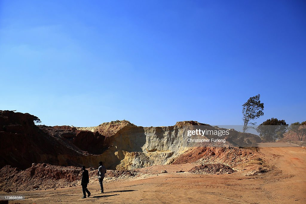 Two men walk through a mine dump on July 15, 2013 in Johannesburg, South Africa. Johannesburg became the centre of gold mining in 1886 when gold was first discovered. Two government officials were sent to establish a settlement and named it Johannesburg after the first name they both shared. The gold rush lasted for over 100 years. The South African mining industry has shed more than 340,000 jobs since 1990 but is still the fifth largest gold producer in the world and has vast amounts of other minerals still to be unearthed.