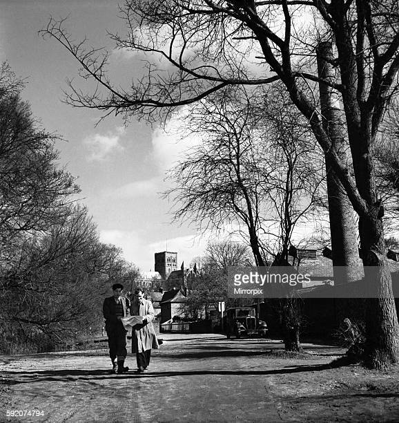 Two men walking through the park in St Albans with the cathedral in the background March 1952 C1266001