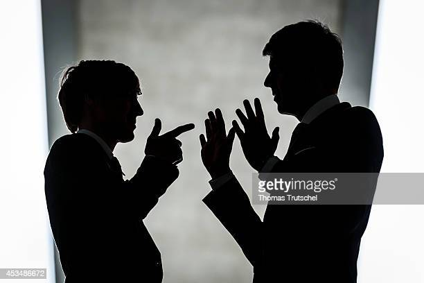 Two Men wearing business business suits have an argument on August 07 2014 in Berlin Germany