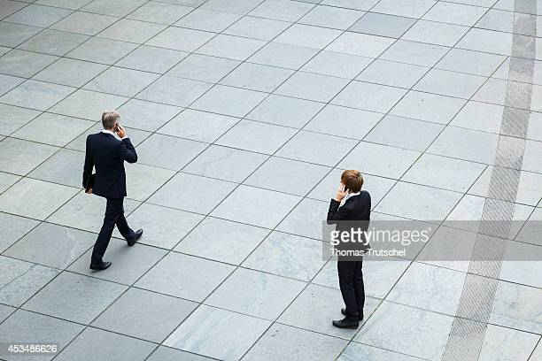 Two men wearing business business suits use their cellphones on August 07 2014 in Berlin Germany