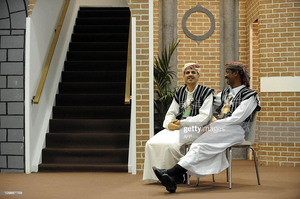 Two men wearing traditional clothing chat at the Yemeni stand on March 9 2011 at the ITB travel trade fair in Berlin More than 11000 exhibitors from...