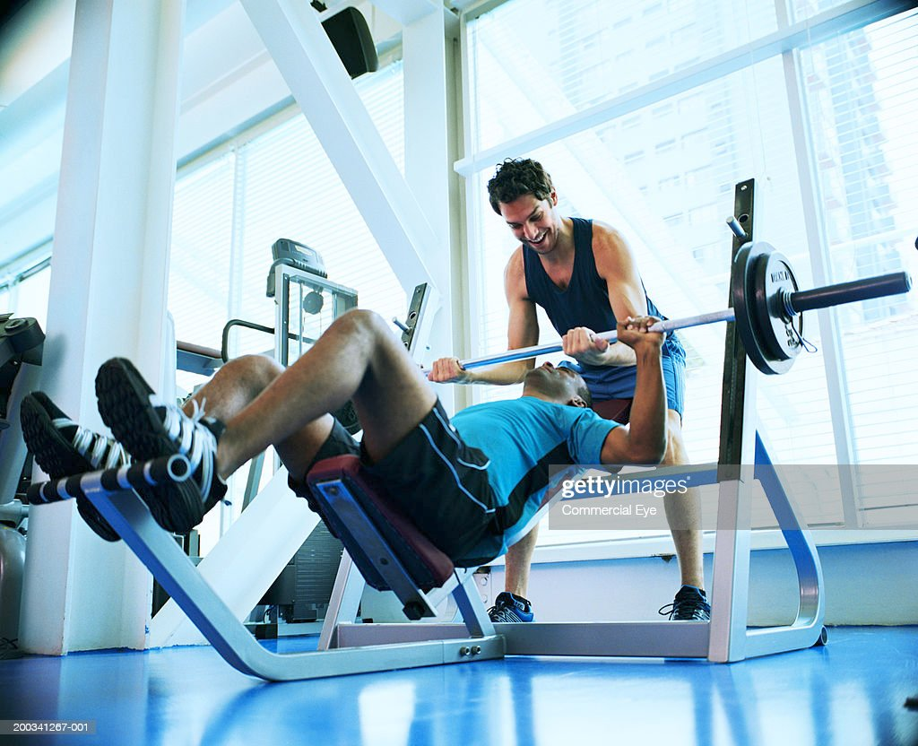Two men weight training in gym, low angle view : Stock Photo