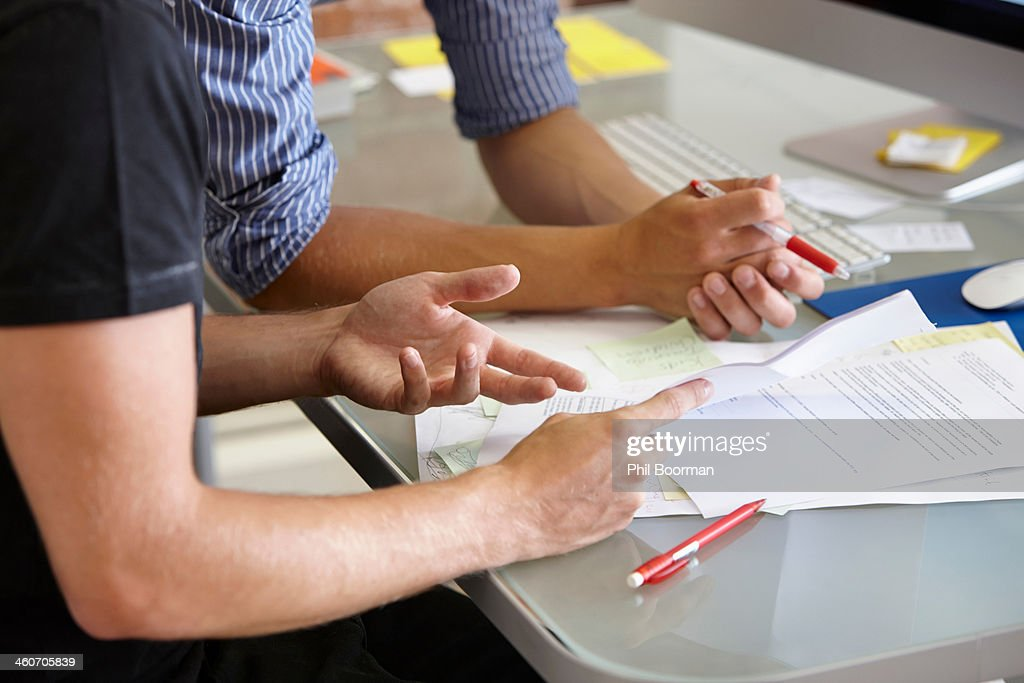Two men with paperwork, close up : Stock Photo