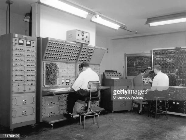 Two men working at a General Precision Systems analog computer circa 1951