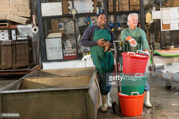 Two men working in a food processing plant