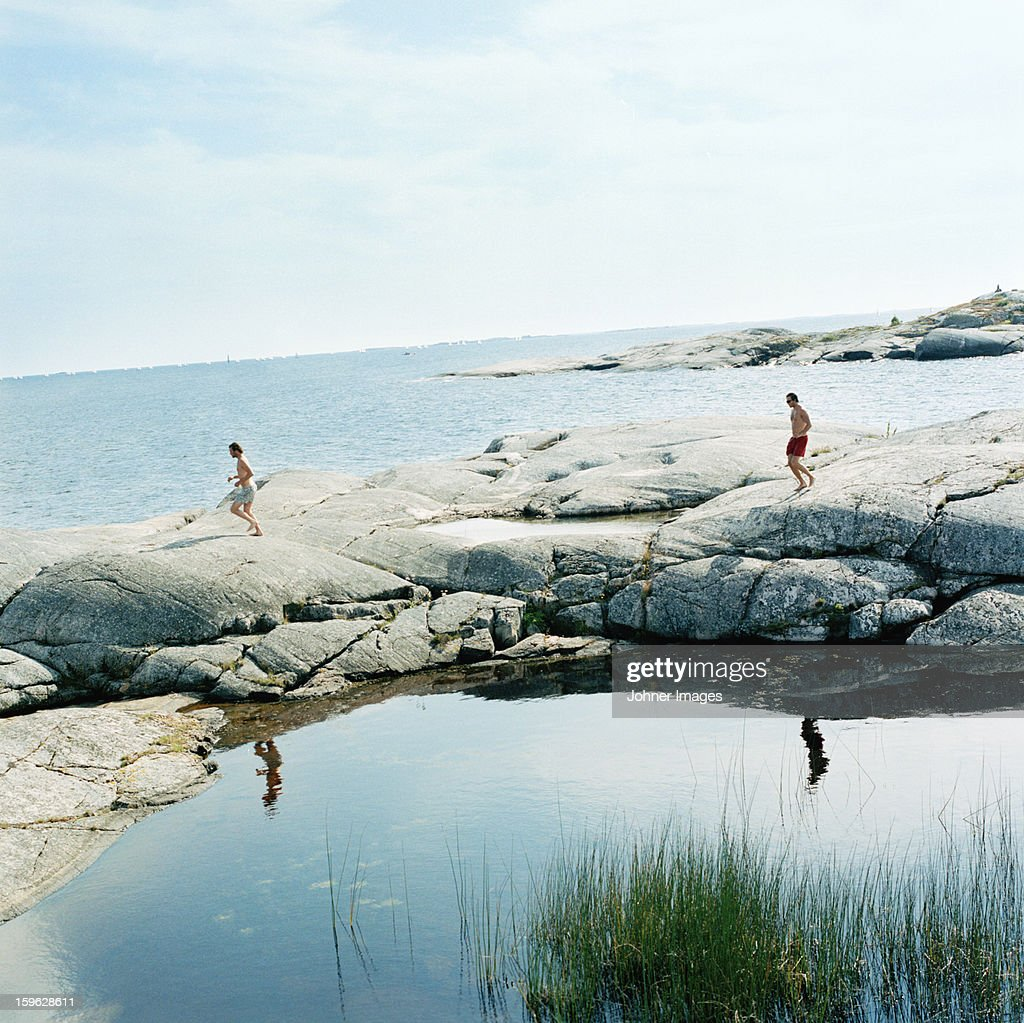 Two men working out in the archipelago, Sweden.