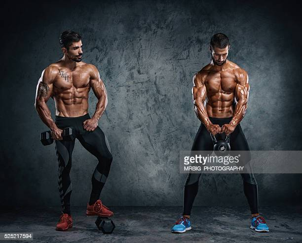 Two Men Working Out With Weights