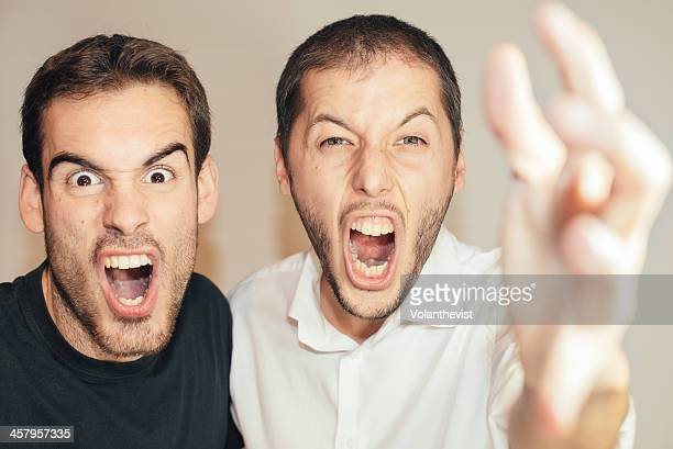 Two men yelling w/ expressive face and gestures