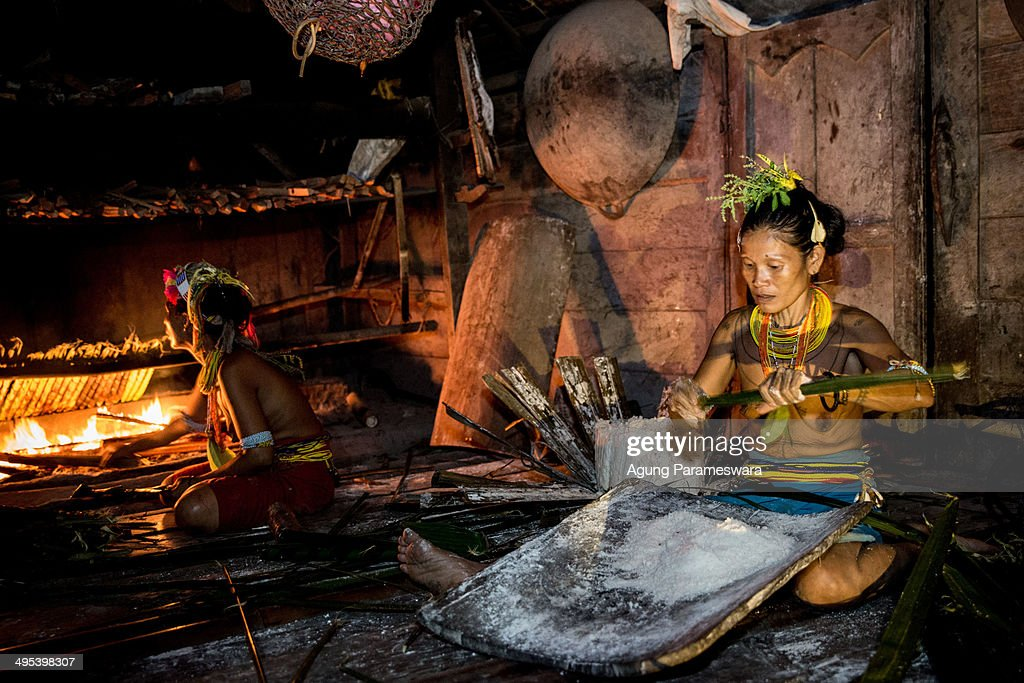 Two Mentawanese women Bai Lepon and Bai LauLau cook sagoo during Inauguration Ritual preparation for Aman Gotdai as a New Sikerei on May 24 2014 in...