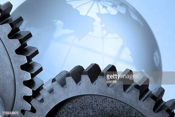 Two meshing gears in front of crystal globe