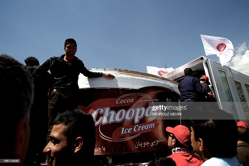 A two metres (6.5 feet) in diameter and 1.60 metres (5.2 feet) in height pot filled with five tons of chocolate ice cream of Iranian dairy product company Choopan (shepherd) is unveiled during a ceremony in the foothills of Tochal in northern Tehran on April 1, 2013 . The dairy company hopes their ice cream pot will make it into the Guinness Book of Records. The current record is held since September 2005 by the American global ice cream parlor, Baskin-Robbins that had accumulated 4.02 tonnes (8,865 pounds) of vanilla ice cream in a pot.