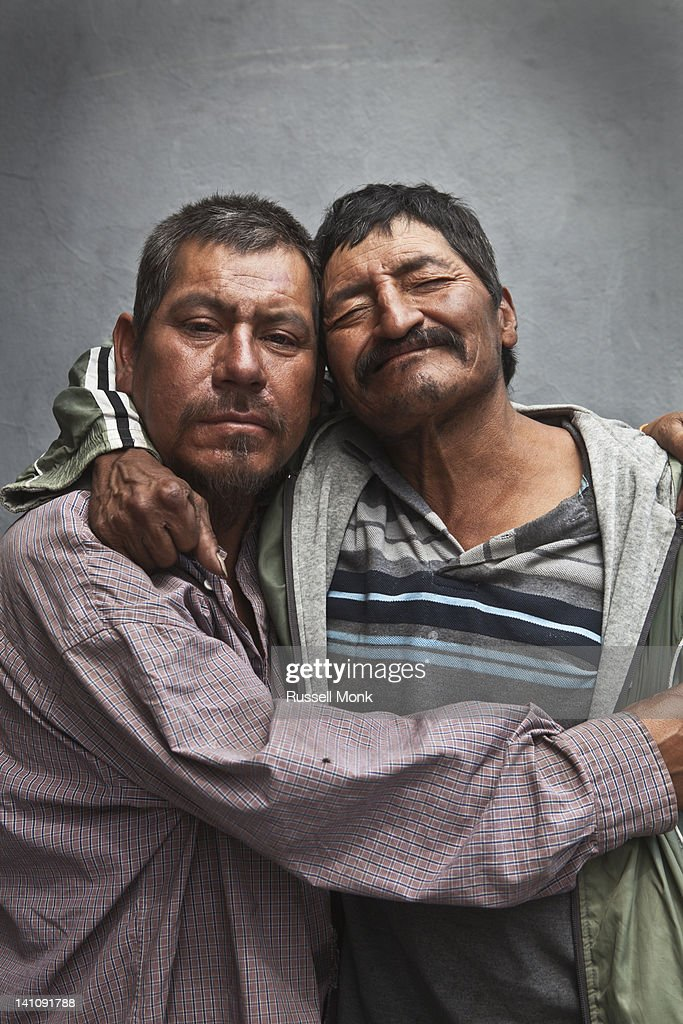 Two mexican drunk men holding each other. : Stock Photo
