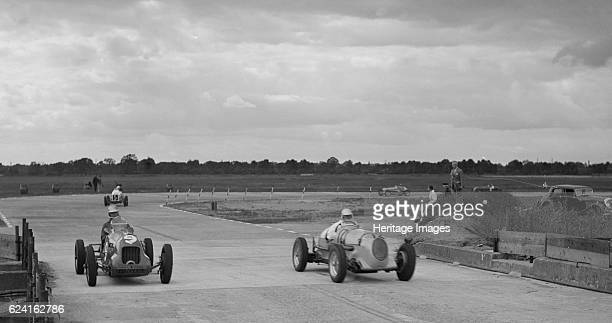 Two MGs racing at Brooklands Surrey c1930s Artist Bill BrunellRight MG Event Entry No 12 Left MG Event Entry No 9 Background Unidentified car Event...