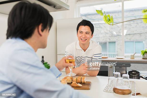 Two mid adult friends talking