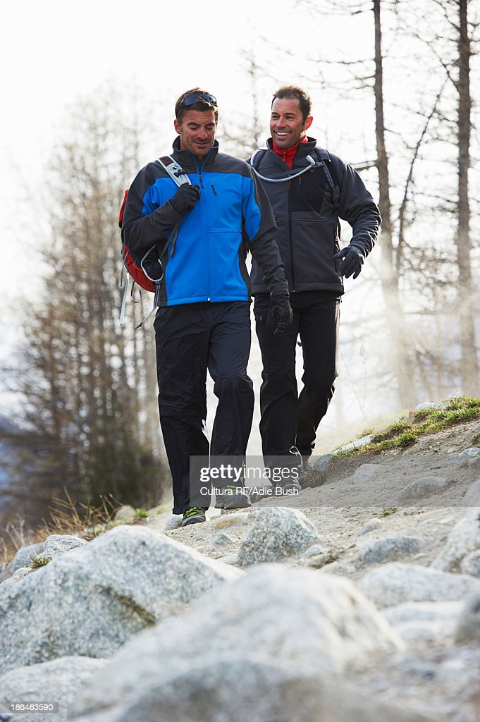 Two mid adult men hiking : Stock Photo