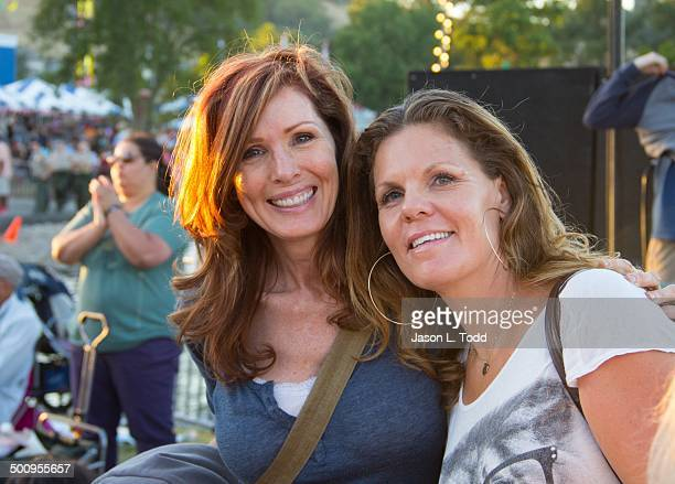 Two middle aged woman at outdoor music festival smiling Marin county fourth if July fair San Rafael California