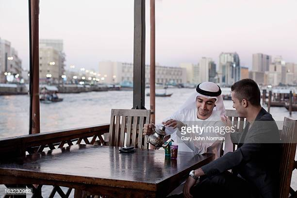 Two Middle Eastern Businessmen drinking tea